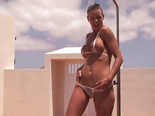 Sexy dark brown milf getting undressed and juicy outdoor shower