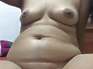 Oriental milf masturbating