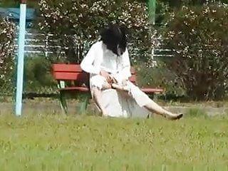 Oriental milf in public playground