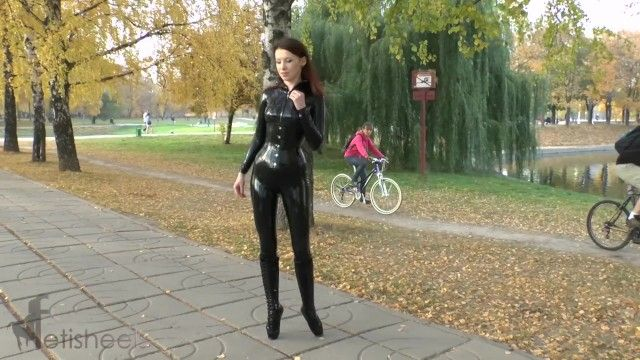 Hot redhead in latex catsuit and balletboots walking in public