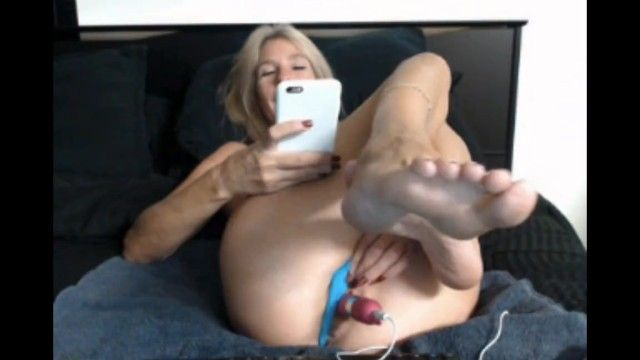 Concupiscent milf plays with cunt and shows soles on webcam